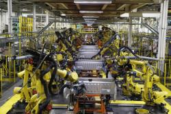 In this Sept. 27, 2018 file photo, robots weld the bed of a 2018 Ford F-150 truck on the assembly line at the Ford Rouge assembly plant in Dearborn, Mich.