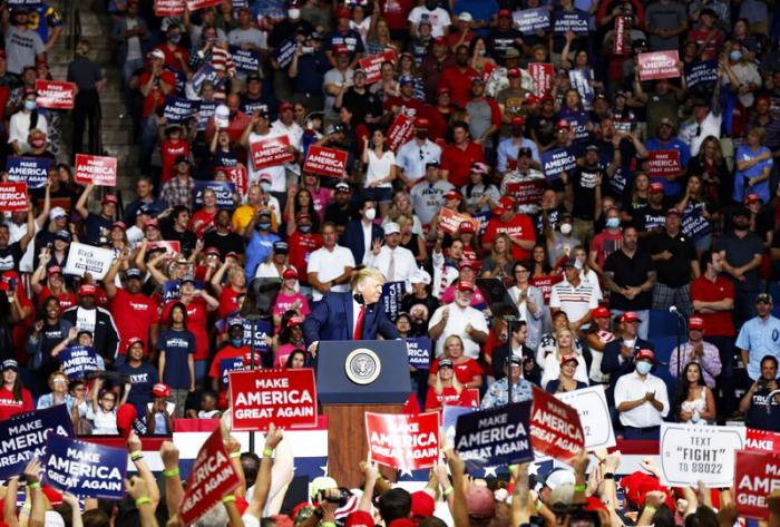 In this Saturday, June 20, 2020, file photo, President Donald Trump speaks at BOK Center during his rally in Tulsa, Okla.