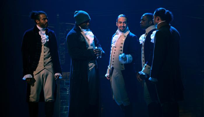"from left, Daveed Diggs, Okieriete Onaodowan, Lin-Manuel Miranda, Leslie Odom Jr. and Anthony Ramos appear in a filmed version of the original Broadway production of ""Hamilton."""
