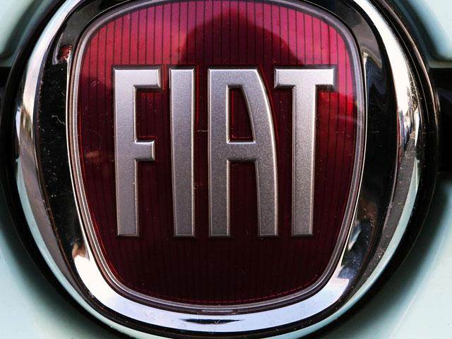 In this Oct. 31, 2019 file photo, a Fiat logo is pictured on a car in Bayonne, southwestern France