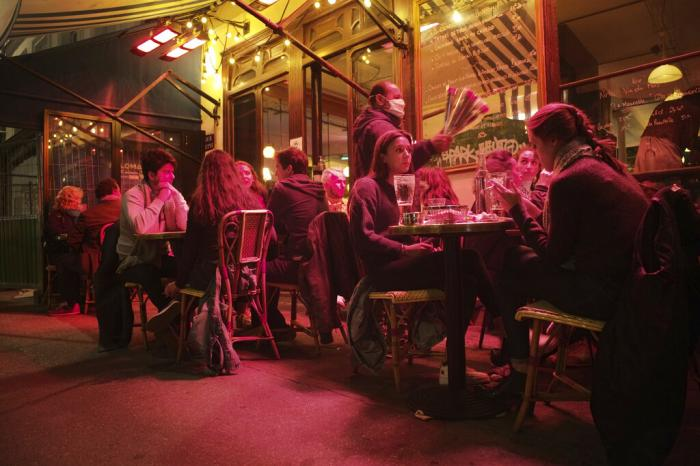 In this Sept.26, 2020 file photo, people enjoy a drink in a cafe terrace in Paris.