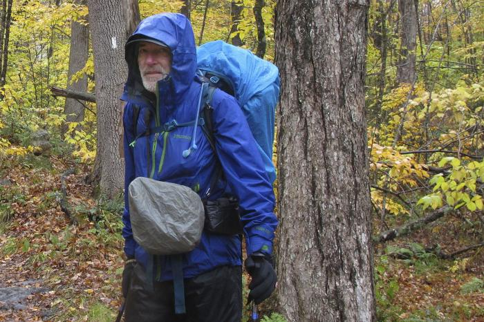 Artist Rob Mullen stands on Long Trail, the country's oldest long distance trail, in Manchester, Vt., on Tuesday, Oct. 13, 2020.