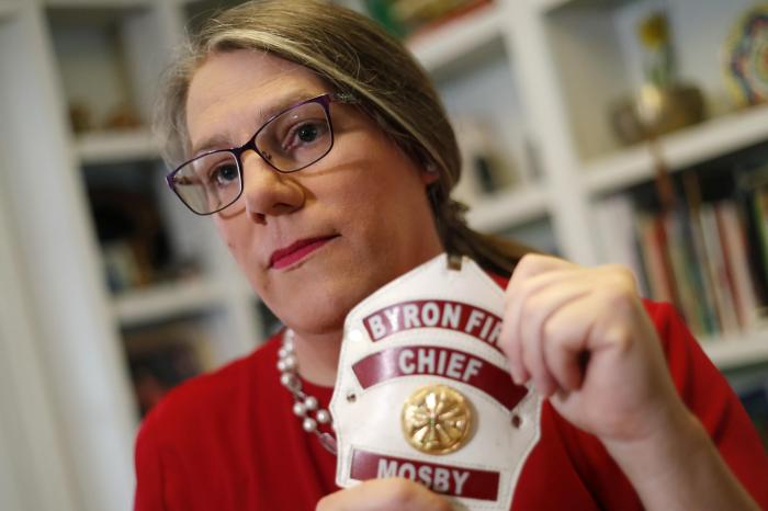 Former Byron, Ga., fire chief Rachel Mosby poses for a photo in the home of a friend in Atlanta.