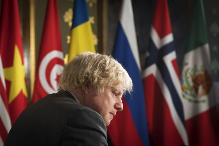 Britain's Prime Minister Boris Johnson chairs a session of the UN Security Council on climate and security at the Foreign, Commonwealth and Development Office in London.
