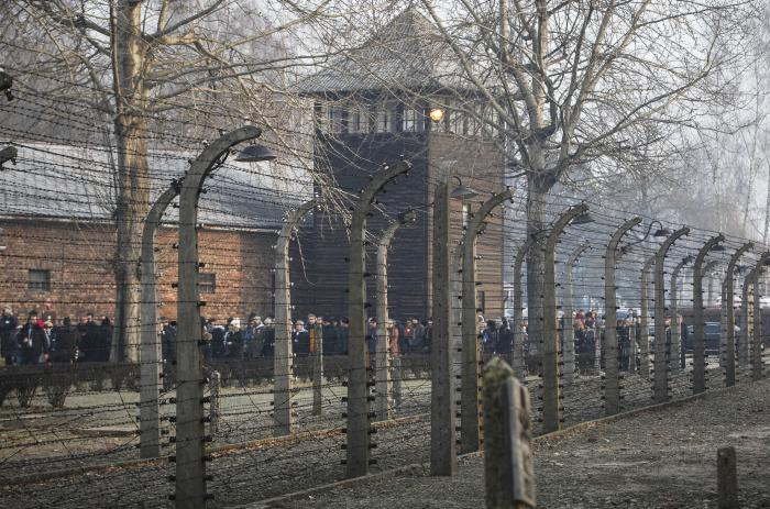 People are seen arriving at the site of the Auschwitz-Birkenau Nazi German death camp.