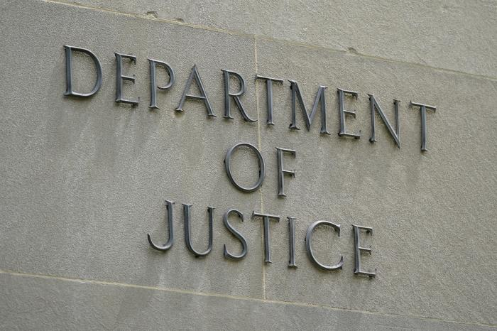 This May 4, 2021, photo shows a sign outside the Robert F. Kennedy Department of Justice building in Washington.