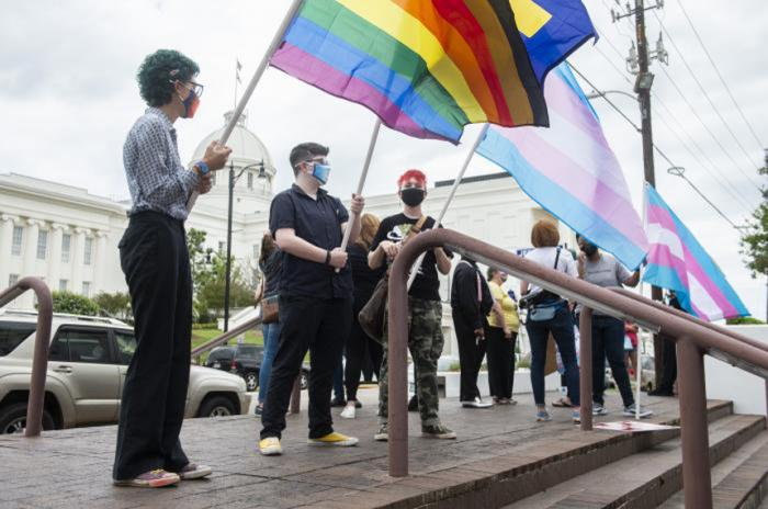 Protestors in support of transgender rights rally outside the Alabama State House in Montgomery, Alabama, on Tuesday, March 30, 2021.