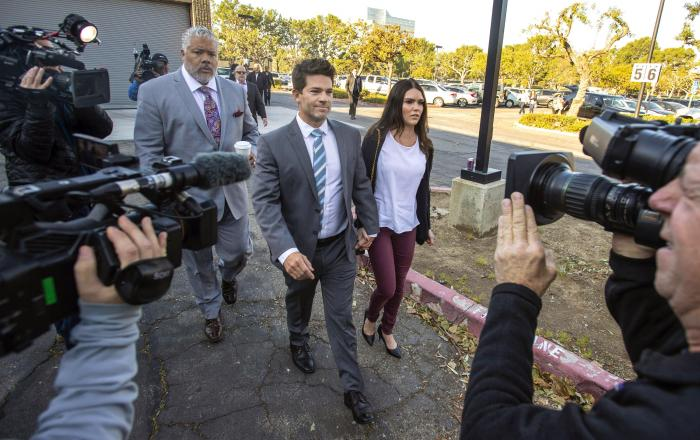 In this Friday, Feb. 7, 2020, file photo, Grant Robicheaux, center, and Cerissa Riley, arrive at Orange County Superior Court Harbor Justice Center in Newport Beach, Calif.
