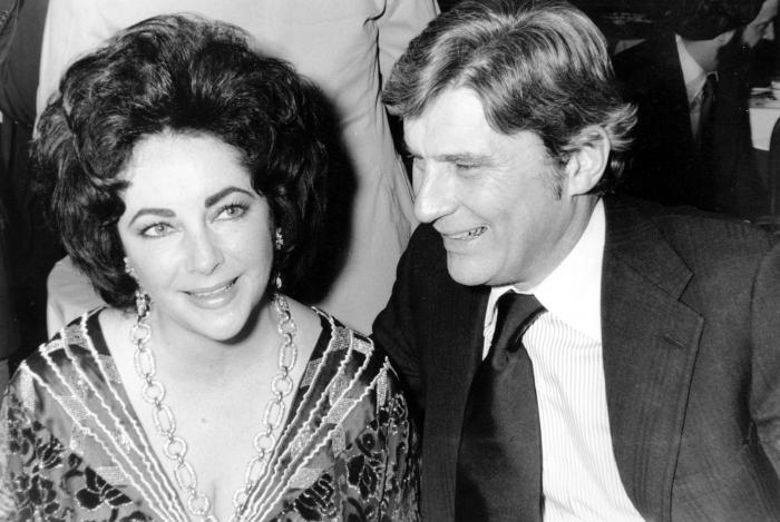 Actress Elizabeth Taylor and her husband, former secretary of the U.S. Navy John Warner attend the 42nd New York Film Critics Circle Awards dinner in New York.