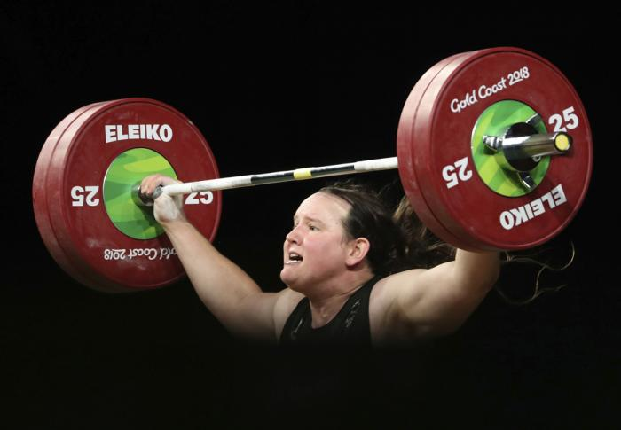 In this April 9, 2018 file photo, New Zealand's Laurel Hubbard lifts in the snatch of the women's +90kg weightlifting final at the 2018 Commonwealth Games on the Gold Coast, Australia