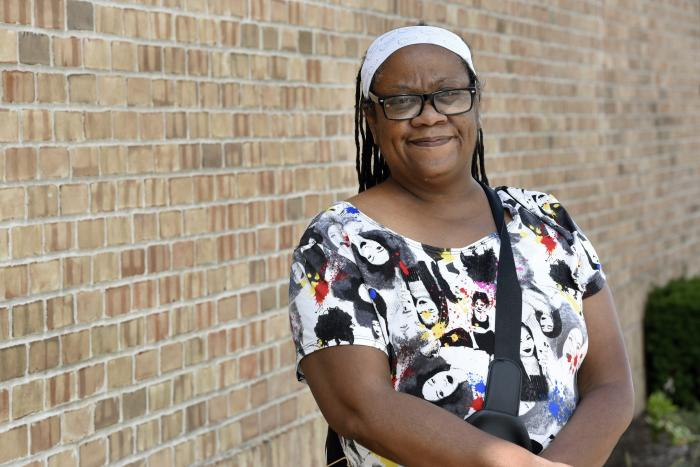Regina Howard poses for a photo in Southfield, Mich., Friday, July 30, 2021. Lakeshore Legal Aid successfully helped Howard receive $24,550 in federal funds to pay for 15 months of rent. (AP Photo/Jose Juarez)