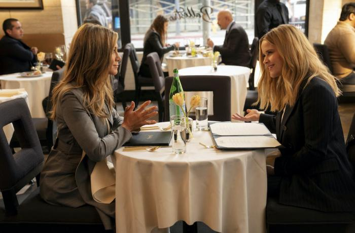 """Jennifer Aniston, left, and Reese Witherspoon in a scene from """"The Morning Show."""""""